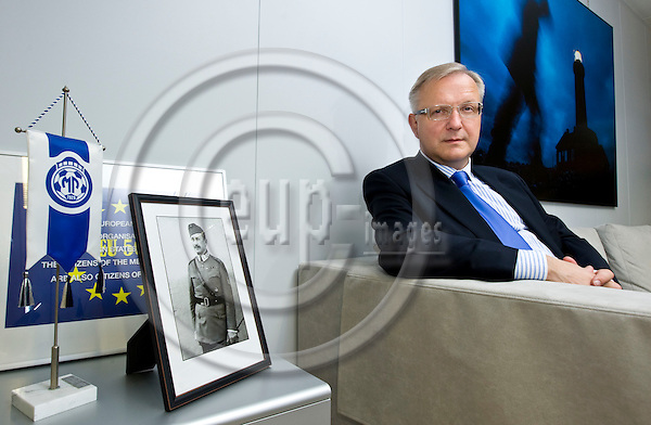 BRUSSELS - BELGIUM - 19 NOVEMBER 2010 -- Olli REHN (Fin.), European Commissioner, in charge of Economic and Monetary Affairs in his office. A portrait of Marshal Carl Gustav Emil MANNERHEIM (President of Finland 1944-1946, Commander-in-Chief of the armed forces 1918 - 1919 and 1939 - 1946)  -- PHOTO: Juha ROININEN / EUP-Images.