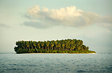 INDONESIA, Mentawai Islands, Kandui Resort,  an island covered in palm trees