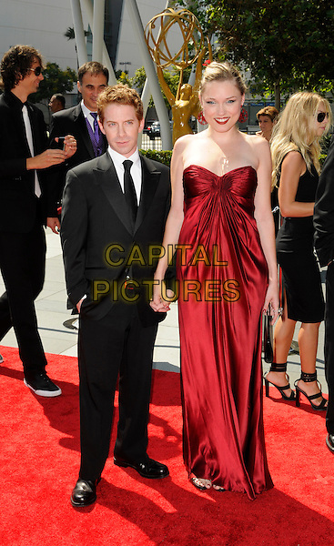 SETH GREEN & CLARE GRANT.The 2009 Creative Arts Emmy Awards at the Nokia Theatre in Los Angeles, California.  .September 12th, 2009.emmys full length claire red dress strapless maxi long ruched black sandals holding hands black suit couple .CAP/ROT.©Lee Roth/Capital Pictures