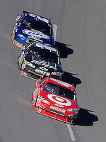 Nov. 1, 2009; Talladega, AL, USA; NASCAR Sprint Cup Series driver Juan Pablo Montoya (42) leads Dale Earnhardt Jr (88) and Kurt Busch (2) during the Amp Energy 500 at the Talladega Superspeedway. Mandatory Credit: Mark J. Rebilas-