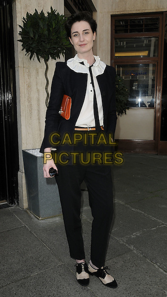 ERIN O'CONNOR.The Belvedere Bloody Mary Brunch, Le Caprice, Arlington St., London, England..April 7th, 2011.full length black suit hand in pocket jacket trousers two tone shoes blouse.CAP/CAN.©Can Nguyen/Capital Pictures.
