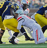 Ohio State Buckeyes line backer Ryan Shazier (2) makes a tackle on Michigan Wolverines running back Derrick Green (27) in the 3rd quarter of their college football game at Michigan Stadium in Ann Arbor, Michigan on November 30, 2013.  (Dispatch photo by Kyle Robertson)