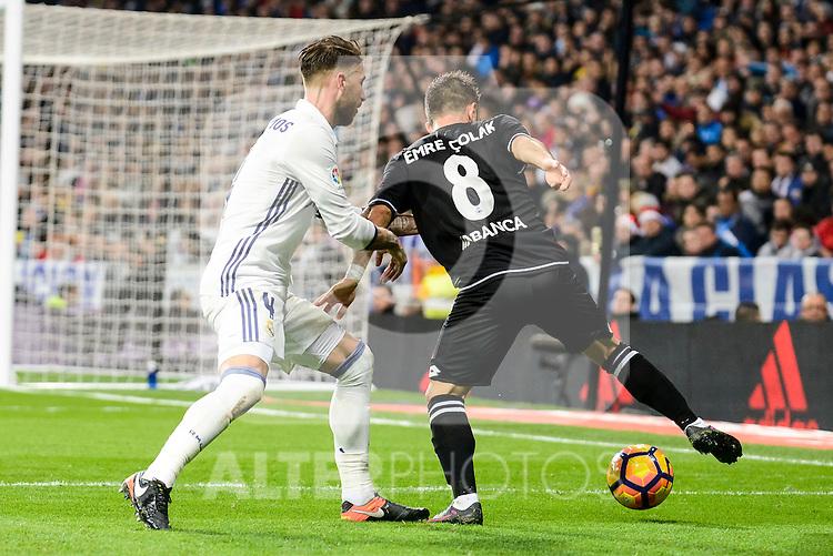 Real Madrid Sergio Ramos and Deportivo de la Coruña Emre Colak during La Liga match between Real Madrid and Deportivo de la Coruña at Santiago Bernabeu Stadium in Madrid, Spain. December 10, 2016. (ALTERPHOTOS/BorjaB.Hojas)
