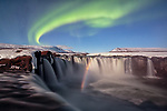 Waterfall with rainbow and northern lights by Mauro Tronto