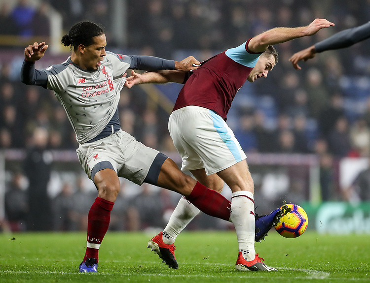 Burnley's Sam Vokes competing with Liverpool's Virgil van Dijk<br /> <br /> Photographer Andrew Kearns/CameraSport<br /> <br /> The Premier League - Burnley v Liverpool - Wednesday 5th December 2018 - Turf Moor - Burnley<br /> <br /> World Copyright &copy; 2018 CameraSport. All rights reserved. 43 Linden Ave. Countesthorpe. Leicester. England. LE8 5PG - Tel: +44 (0) 116 277 4147 - admin@camerasport.com - www.camerasport.com