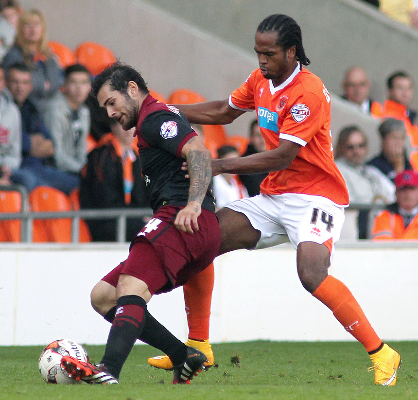 Norwich City's Bradley Johnson shields the ball from Blackpool's Nathan Delfouneso<br /> <br /> Photographer Rich Linley/CameraSport<br /> <br /> Football - The Football League Sky Bet Championship - Blackpool v Norwich City - Saturday 27th September 2014 - Bloomfield Road - Blackpool<br /> <br /> &copy; CameraSport - 43 Linden Ave. Countesthorpe. Leicester. England. LE8 5PG - Tel: +44 (0) 116 277 4147 - admin@camerasport.com - www.camerasport.com