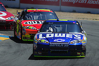 Jun. 21, 2009; Sonoma, CA, USA; NASCAR Sprint Cup Series driver Jimmie Johnson leads teammate Jeff Gordon during the SaveMart 350 at Infineon Raceway. Mandatory Credit: Mark J. Rebilas-