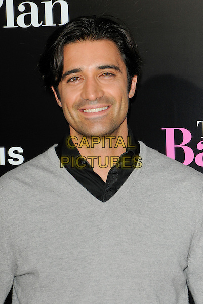 "GILLES MARINI .arriving at the premiere of CBS Films' ""The Back-up Plan"" at the Regency Village Theatre in Westwood, California, USA, April 21st 2010..arrivals portrait headshot smiling v-neck  grey gray jumper sweater black shirt  .CAP/ROT.©Lee Roth/Capital Pictures"