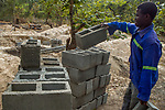 Man carrying bricks to build new anti-poaching base, Kafue National Park, Zambia