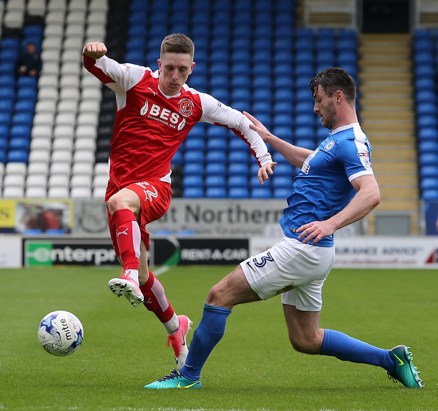 Fleetwood Town's Ashley Hunter gets away from Peterborough United's Andrew Hughes<br /> <br /> Photographer David Shipman/CameraSport<br /> <br /> The EFL Sky Bet League One - Peterborough United v Fleetwood Town - Friday 14th April 2016 - ABAX Stadium  - Peterborough<br /> <br /> World Copyright &copy; 2017 CameraSport. All rights reserved. 43 Linden Ave. Countesthorpe. Leicester. England. LE8 5PG - Tel: +44 (0) 116 277 4147 - admin@camerasport.com - www.camerasport.com