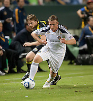 Galaxy midfielder Chris Birchall (11) moves the ball up the pitch during the second half of the game between LA Galaxy and the Columbus Crew at the Home Depot Center in Carson, CA, on September 11, 2010. LA Galaxy 3, Columbus Crew 1.
