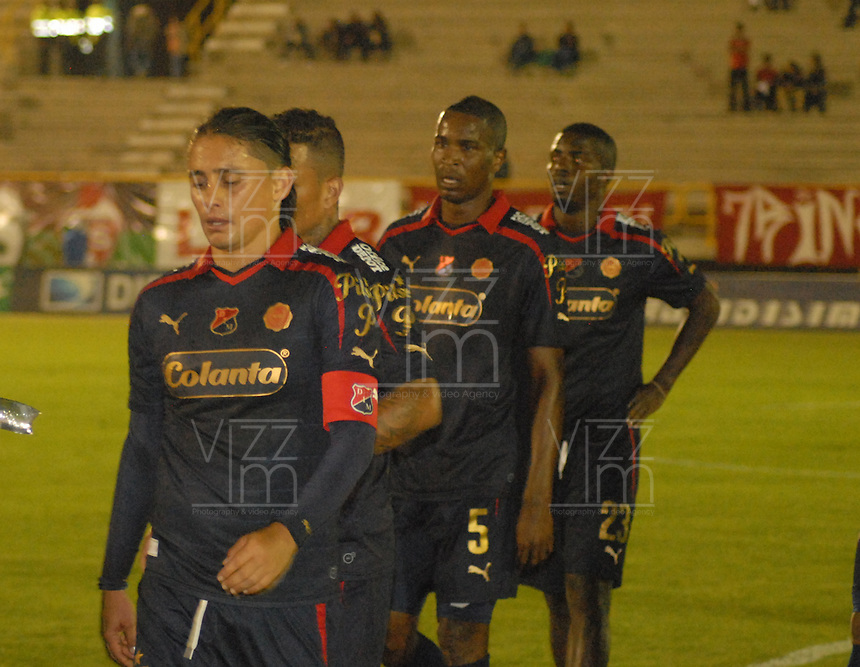 TUNJA - COLOMBIA -13 -03-2014: Los jugador de Deportivo Independiente Medellin, durante partido por la decima fecha  de la Liga Postobon I-2014, jugado en el estadio La Independencia de la ciudad de Tunja. / The players of Deportivo Independiente Medellin, during a match for the tenth date of the Liga Postobon I-2014 at the La Independencia  stadium in Tunja city, Photo: VizzorImage  / Jose M. Palencia / Str. (Best quality available)