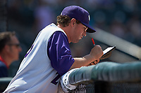 Winston-Salem Dash pitching coach Matt Zaleski (25) makes notes during the game against the Buies Creek Astros at BB&T Ballpark on July 15, 2018 in Winston-Salem, North Carolina. The Dash defeated the Astros 6-4. (Brian Westerholt/Four Seam Images)