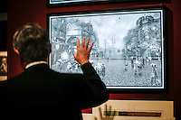 New York City, NY. 06 November 2014. A man observes an artwork during the IFPDA Print Fair, at the Park Avenue Armory in new york