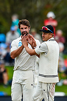 Colin De Grandhomme of the Black Caps and Neil Wagner of the Black Caps celebrates the wicket of Stuart Broad of England during Day 4 of the Second International Cricket Test match, New Zealand V England, Hagley Oval, Christchurch, New Zealand, 2nd April 2018.Copyright photo: John Davidson / www.photosport.nz