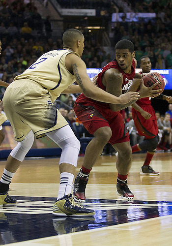 February 09, 2013:  Louisville forward Chane Behanan (21) drives to the basket as Notre Dame forward Zach Auguste (2) defends during NCAA Basketball game action between the Notre Dame Fighting Irish and the Louisville Cardinals at Purcell Pavilion at the Joyce Center in South Bend, Indiana.  Notre Dame defeated Louisville 104-101 in five overtimes.