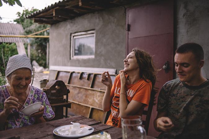 Alexander, Katrine and her grandmother at the courtyard of parentshouse. Ribnita, Transnistria