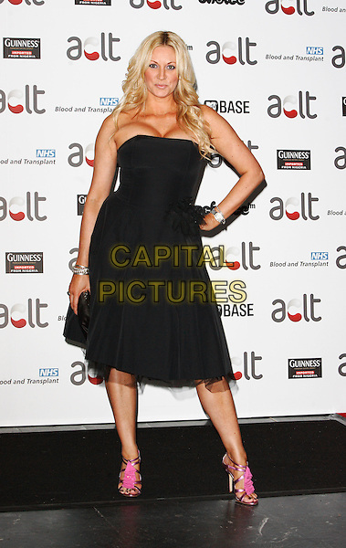 SARAH BOSNICH .Afro Caribbean Leukaemia Trust Gift Of Life Ball at the Inter-Continental Hotel, Park Lane, London, England, September 20th 2008..full length black strapless hand on hip dress hand on hip pink shoes .CAP/ROS.©Steve Ross/Capital Pictures