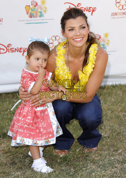 "ALI LANDRY & ESTELA.The 20th annual ""A Time for Heroes"" Celebrity Carnival benefiting Elizabeth Glaser Pediatric AIDS Foundation held at Wadsworth Theater on the Veteran Administration Lawn in West Los Angeles, California, USA. .June 7th, 2009.full length blue jeans denim yellow top kneeling crouching cleavage daughter mother mom mum family pink dress.CAP/DVS                                                  .©Debbie VanStory/Capital Pictures."