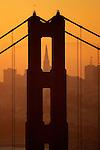 The Golden Gate Bridge tower frames the Transamerican Pryramid in  San Francisco, California.