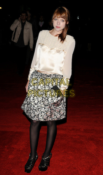 ANTONIA CAMPBELL-HUGHES.attends the premiere for 'Bright Star' during the Times BFI 53rd London Film Festival at the Odeon Leicester Square, London, England,.October 19th 2009..full length white cream blouse top silk satin long sleeved sleeves print skirt silver metallic floral patterned black shoes tights peep toe platform sandals .CAP/CAN.©Can Nguyen/Capital Pictures.
