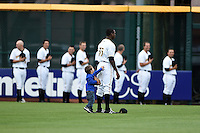 Bradenton Marauders outfielder Raul Fortunato (35) has a young fan trying to get his attention during the national anthem as the bullpen watches before a game against the Jupiter Hammerheads on April 17, 2014 at McKechnie Field in Bradenton, Florida.  Bradenton defeated Jupiter 2-1.  (Mike Janes/Four Seam Images)