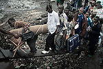 KISANGANI, DEMOCRATIC REPUBLIC OF CONGO MARCH 12: Passengers board a boat for the capital Kinshasa on March 12, 2006 in Kisangani, in Congo, DRC. The country has hardly any infrastructure, and the Congo River is a lifeline for millions of people, who depend on it for transport and trade. The journey from Kisangani to Kinshasa is about 1750 kilometers, and it takes from 3-7 weeks on the river, depending on the boat. During the Mobuto era, big boats run by the state company ONATRA dominated the traffic on the river. These boats had cabins and restaurants etc. All the boats are now private and are mainly barges that transport goods. The crews sell tickets to passengers who travel in very bad conditions, mixing passengers with animals, goods and only about two toilets for five hundred passengers. The conditions on the boats often resemble conditions in a refugee camp. Congo is planning to hold general elections by July 2006, the first democratic elections in forty years. (Photo by Per-Anders Pettersson)