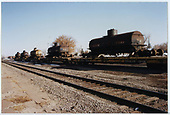 3/4 view of 5 tank cars on flat cars at Alamosa.  Can distinguish cars #50 and #65.<br /> C&amp;TS  Alamosa, CO