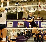 SIOUX FALLS, SD - SEPTEMBER 19:  Sydney Hunsley #8 from Augustana looks for the block on a kill attempt by Makenna Rockeman #8 from the University of Sioux Falls during their match Saturday afternoon at the Stewart Center. (Photo by Dave Eggen/Inertia)