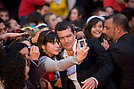 Spanish film actor Antonio Banderas pauses on the red carpet to take a photo with a fan during 12 Festival de Málaga Cine Español 2009, Saturday, April 18, 2009, in Málaga, Spain. (Eduard Ockerse/pressphotointl.com)