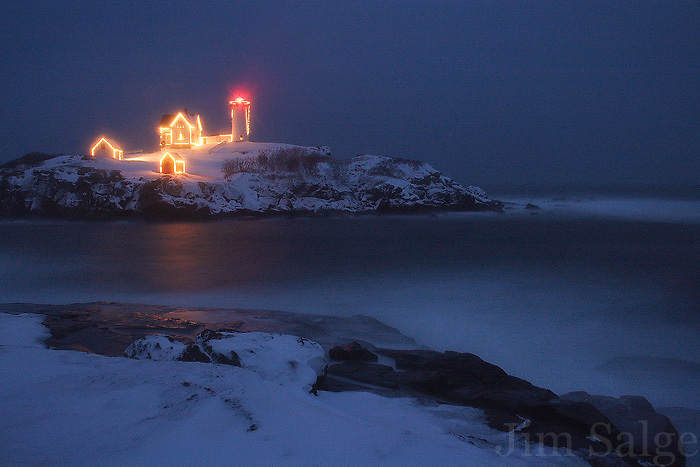 Nubble Lighthouse in York, Maine is an iconic location any time of year, but espeically during the holiday season when it is decked with lights.  Though it wasn't snowing twenty miles inland, a localized storm called a Norlun Trough caused a blizzard right at the coast.  All the snow created a softening filter for the lights on the beacon, which I captured during the blue hour after sunset.