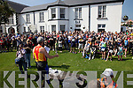 Tim Poullian-Patterson gives a safety briefing to competitors before the start of the Valentia Triathlon on Saturday.  Watched by the Brennan brothers an RTE film crew.