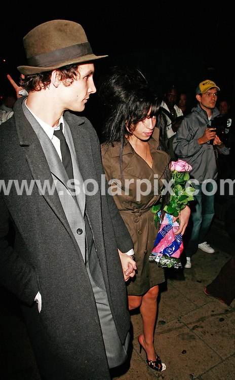 **ALL ROUND PICTURES FROM SOLARPIX.COM**.*WORLDWIDE RIGHTS*.Amy Winehouse's leaves her birthday party celebrations at Century Club, 14th September 2007.This pic:AMY WINEHOUSE.JOB REF:4713-GMT   DATE:14_09_07 .**MUST CREDIT SOLARPIX.COM OR DOUBLE FEE WILL BE CHARGED* *UNDER NO CIRCUMSTANCES IS THIS IMAGE TO BE REPRODUCED FOR ANY ONLINE EDITION WITHOUT PRIOR PERMISSION*