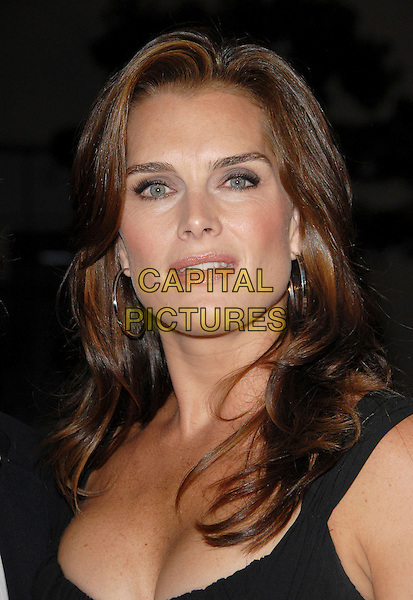 BROOKE SHIELDS.The FX Season 4 Premiere Screening of Nip/Tuck held at The Paramount Studios in Hollywood, California, USA..August 25th, 2006.Ref: DVS.Nip Tuck headshot portrait hoop earrings.www.capitalpictures.com.sales@capitalpictures.com.©Debbie VanStory/Capital Pictures