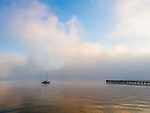 Vashon Island, Washington:<br /> Moored sailboat and pier in clearing fog on Tramp Harbor