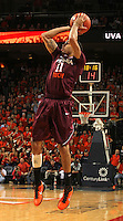 Virginia Tech guard Erick Green (11) shoots the ball during the game Tuesday in Charlottesville, VA. Virginia defeated Virginia Tech73-55.