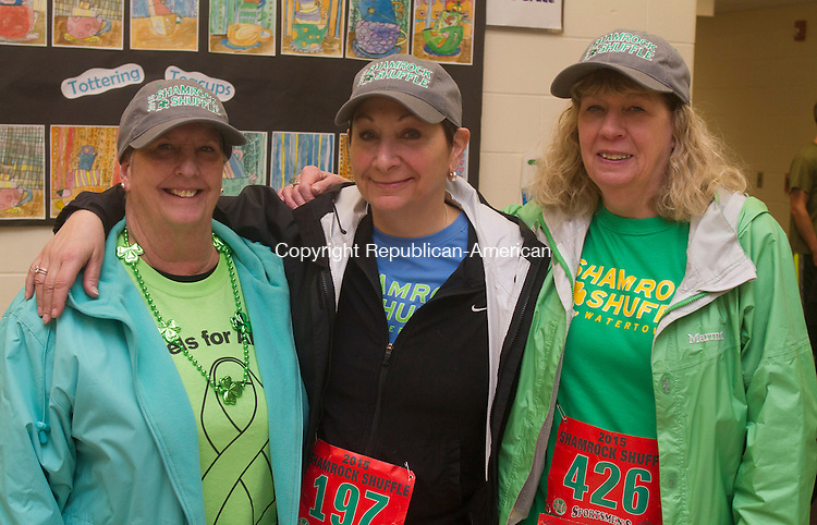 WATERTOWN, CT.- 14 MARCH 2015 - 031415JW05 - Debbie Lutter, Pat Fitz, and Carol Stopper pose for a photo before the start of the 4th Annual Shamrock Shuffle at Polk School Saturday morning.<br /> Jonathan Wilcox Republican-American