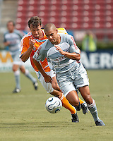 FC Dallas forward Abe Thompson (7) breaks away from Houston Dynamo defender Eddie Robinson (2).  Houston Dynamo beat FC Dallas 2-1 at Robertson Stadium in Houston, TX on June 3, 2007.