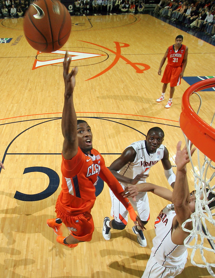 Feb. 2, 2011; Charlottesville, VA, USA; Clemson Tigers guard Demontez Stitt (2) shoots in front of Virginia Cavaliers center Assane Sene (5) and Virginia Cavaliers guard Mustapha Farrakhan (2) during the game at the John Paul Jones Arena. Virginia won 49-47. Mandatory Credit: Andrew Shurtleff