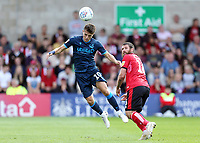 Bristol Rovers' Tom Nichols heads away under pressure from Lincoln City's Michael Bostwick<br /> <br /> Photographer Rich Linley/CameraSport<br /> <br /> The EFL Sky Bet League One - Lincoln City v Bristol Rovers - Saturday September 14th 2019 - Sincil Bank - Lincoln<br /> <br /> World Copyright © 2019 CameraSport. All rights reserved. 43 Linden Ave. Countesthorpe. Leicester. England. LE8 5PG - Tel: +44 (0) 116 277 4147 - admin@camerasport.com - www.camerasport.com