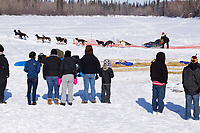 Saturday March 10, 2012  Galena students watch as Kelley Griffin tries to leave the Galena checkpoint. Kelley is waiting for her dogs to finish pooping. Iditarod 2012.