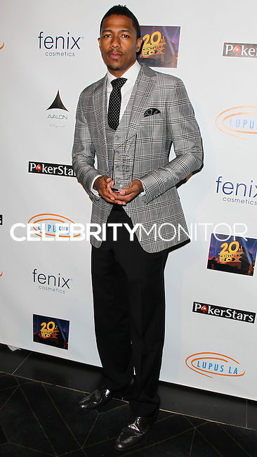 HOLLYWOOD, LOS ANGELES, CA, USA - SEPTEMBER 18: Nick Cannon arrives at the 'Get Lucky For Lupus' 6th Annual Poker Tournament held at Avalon on September 18, 2014 in Hollywood, Los Angeles, California, United States. (Photo by Celebrity Monitor)