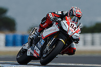 Michel Fabrizio (ITA) riding the Aprilia RSV4 1000 Factory (84) of the Red Devils Roma team exits turn 6 during a qualifying session on day one of round one of the 2013 FIM World Superbike Championship at Phillip Island, Australia.
