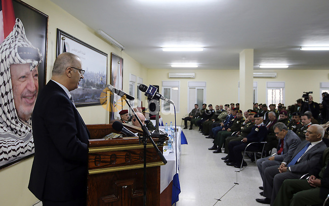 Palestinian Prime Minister Rami Hamdallah speaks during the graduation ceremony of the first group of Palestinian officers academy students, in the West Bank city of Jericho, on December 19, 2016. Photo by Prime Minister Office