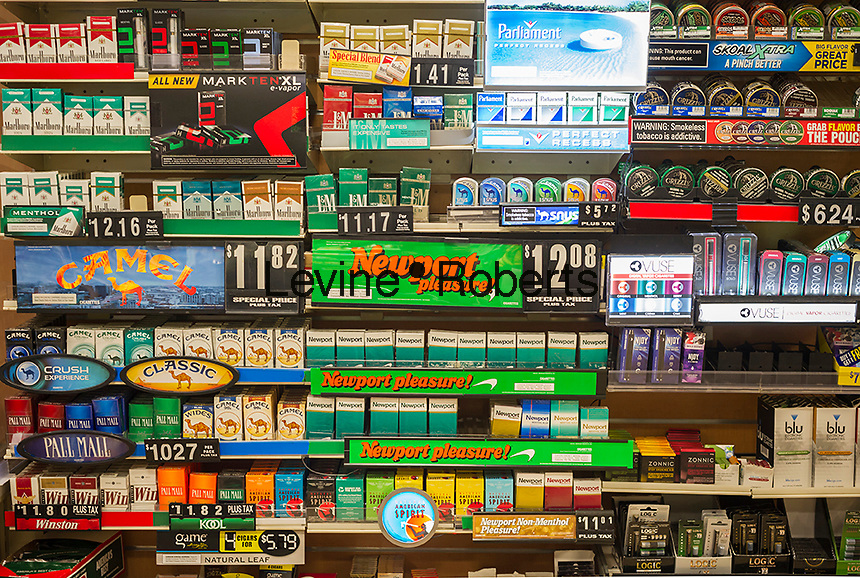 A wall of tobacco products in a convenience store in New York on Monday, May 30, 2016. (© Richard B. Levine)