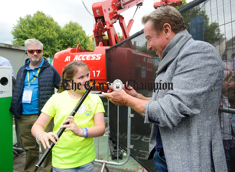Young Sarah Mc Namara of Lisheen, Ballynacally plays a tune for Michael Flatley following the official opening of the All-Ireland Fleadh 2017 in Ennis. Photograph by John Kelly.