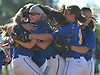 East Meadow teammates celebrate after their 3-1 win over Long Beach in Game 3 of the Nassau County varsity softball Class AA final at Mitchel Athletic Complex on Friday, May 26, 2017. East Meadow took the best-of-three series two games to one.