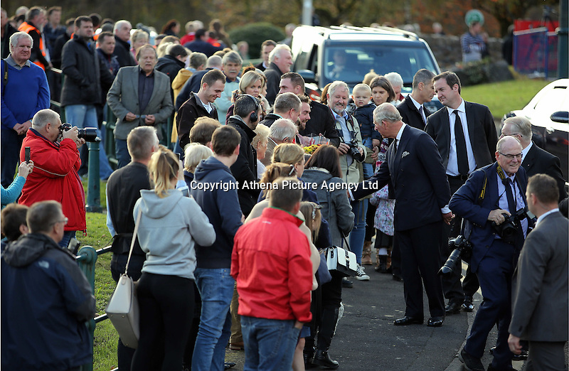 Pictured: Prince Charles greets people after visiting the Memorial Garden Friday 21 October 2016<br />Re: Wales has fallen silent as the country remembered the Aberfan disaster 50 years ago.<br />On 21 October 1966, a mountain of coal waste slid down into a school and houses in the Welsh village, killing 144 people, including 116 children.<br />A day of events to commemorate the disaster included a service at Aberfan Cemetery at 9:15am on Friday.<br />Prince Charles is visiting Aberfan memorial garden before unveiling a plaque in memory of the victims.<br />He will also attend a reception with the families of some of those who lost their lives, before signing a book of remembrance.