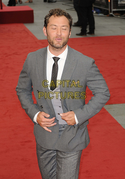 Jude Law.The World Premiere of 'Anna Karenina', The Odeon Leicester Square, London, England..4th September 2012.half length grey gray suit beard facial hair hands waistcoat smiling eyes closed mouth open funny .CAP/CAN.©Can Nguyen/Capital Pictures.