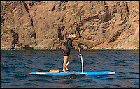 BNPS.co.uk (01202 558833)<br /> Pic: HobieCat/BNPS<br /> <br /> A company has produced the world's first 'pedal' board - a revolutionary paddle board with handlebars.<br /> <br /> The quirky invention, named the Hobie Mirage Eclipse, looks like the cross between a paddle board and a scooter and can be steered using its handlebars.<br /> <br /> You don't need a paddle to move about - instead you gather momentum by walking on two large hinged treads which work a bit like a stepping machine at a gym and are connected to two fins underneath the board.<br /> <br /> To steer the board, you pull the left brake lever, which is attached to the handlebars, to turn left, and the right lever to turn right.